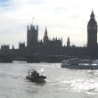 The Houses of Parliament and Clock Tower, from the River Thames